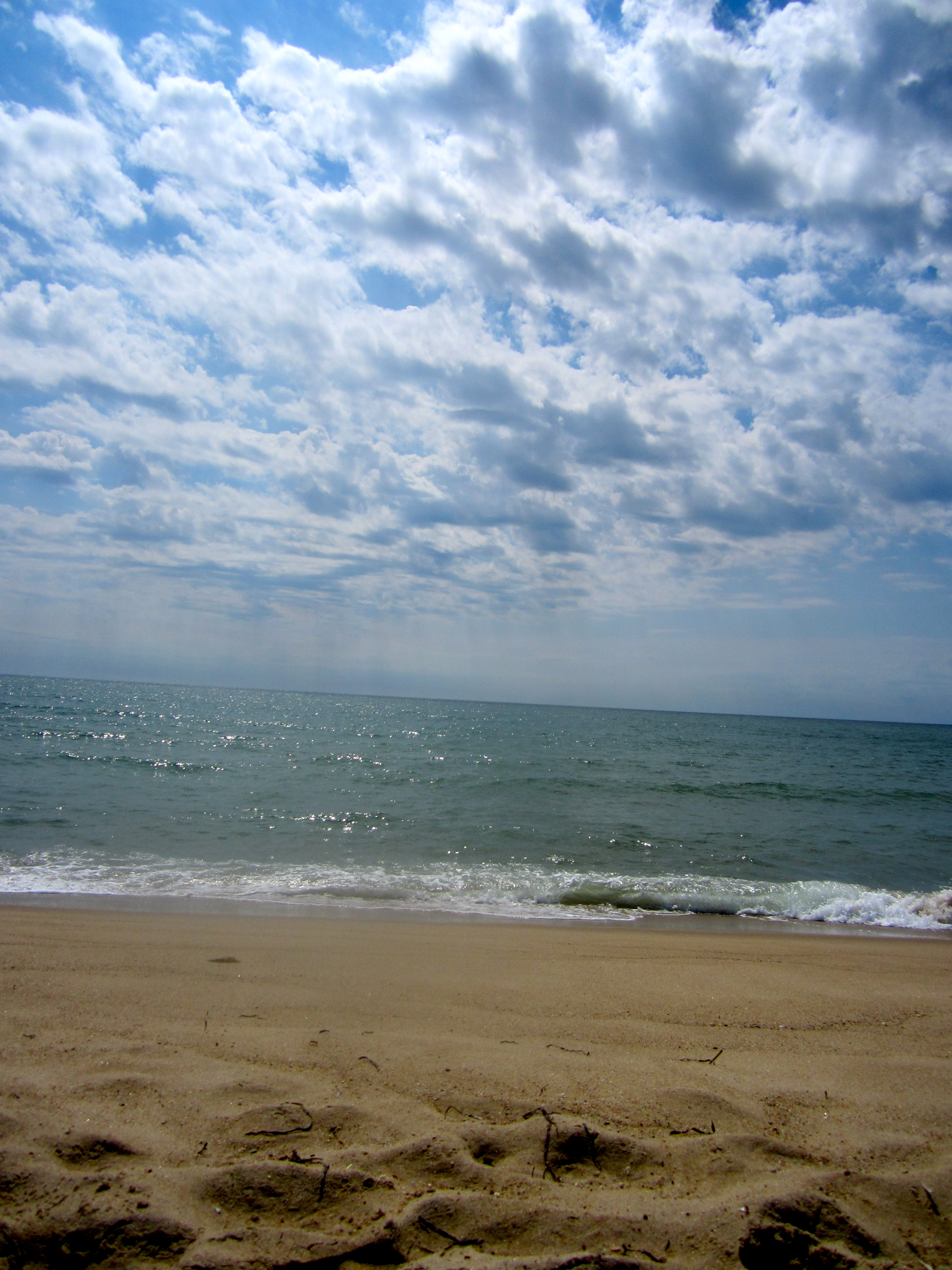 A simple photo, but a beauty. Sky, water, sand.